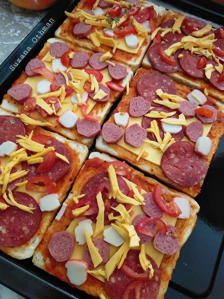 sebuku roti terletak elok atas meja tak terusik jadikan pizza sekelip mata  lesap masuk Resepi Kek Cheese Bakar Sukatan Cawan Enak dan Mudah
